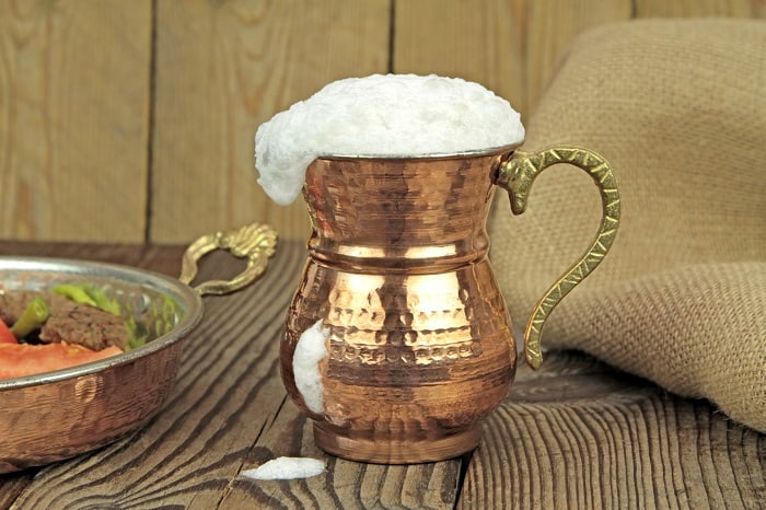 Ayran - traditional Turkish fermented drink in a cooper glass