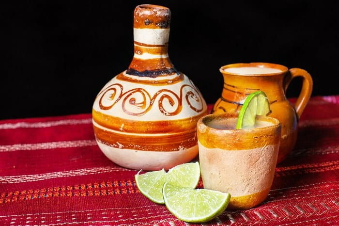 Pulque - traditional Mexican beverage in clay and pitcher