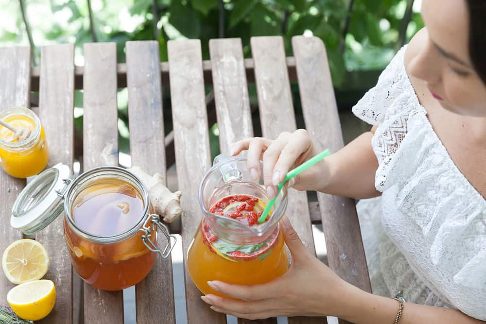 a woman drinking kombucha