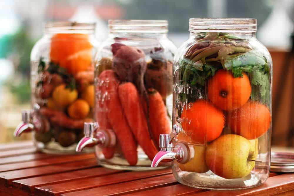 Fruits and vegetables in glass jars