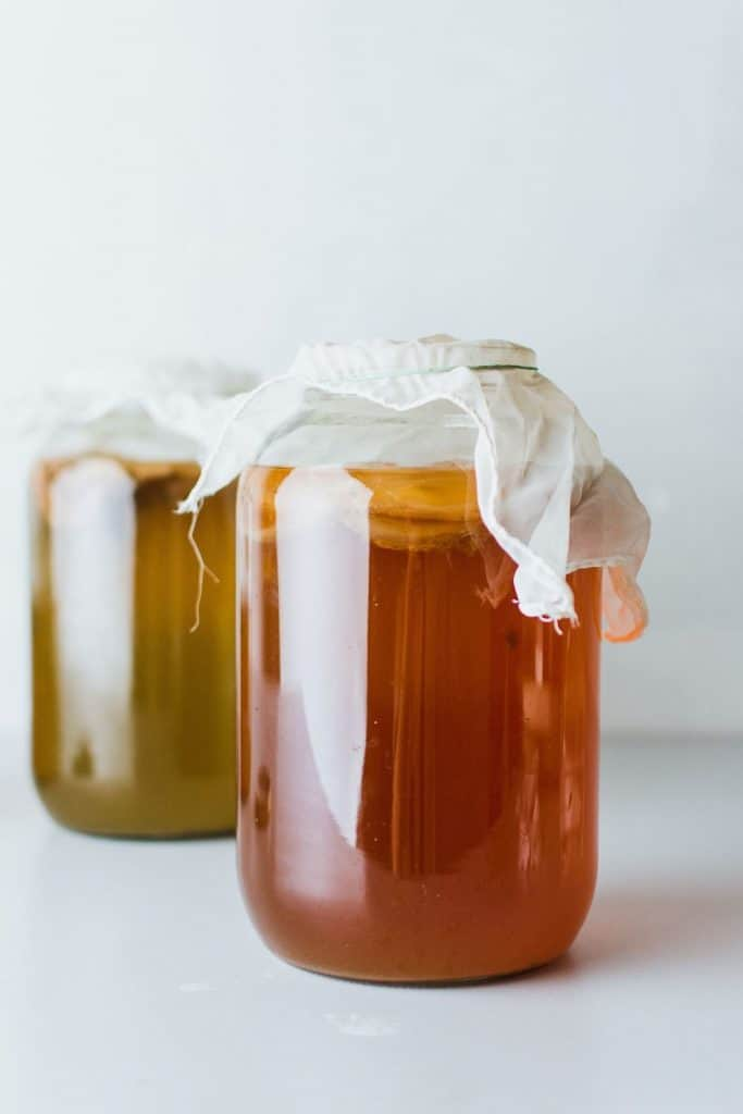 homemade flavored kombucha in glass jars