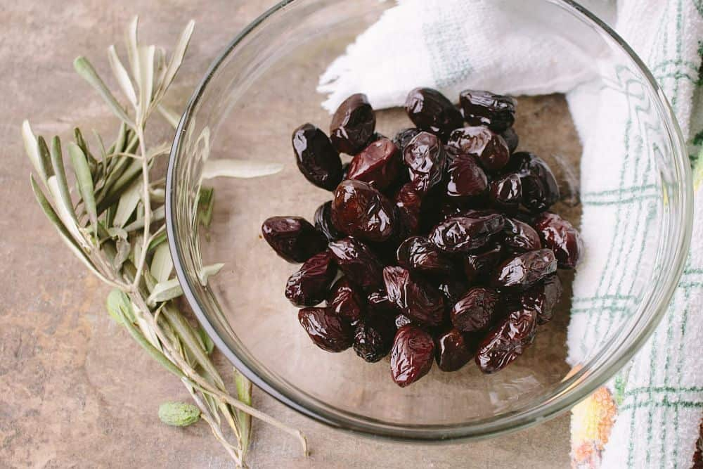 pickled kalamata olives in glass bowl